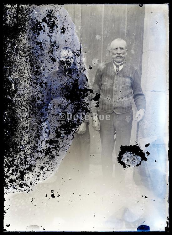 eroding glass plate photo of elderly couple