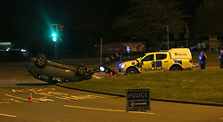 Reading,Berkshire Friday 31st March 2017 A driver has walked away to tell the tail after leaving a trail of destruction on the A329 in Winnersh Berkshire this evening just outside the Showcase Cinema.This is the aftermath of the  moment a car flips in the middle of the road after hitting a traffic light - then slides along carriageway on its roof.<br /> <br /> The incident happened on the A329 Reading Road outside the cinema.  One shocked film goers described hearing a loud bang and the car flying through the air at speed. <br /> The vehicle collides head on with a traffic island, sending debris flying, and is lifted onto two wheels. The car swerves out of control  to other side of the road lands on its roof, and comes to a halt amid a shower of sparks.<br /> <br /> The silver  A3 driver has left thousand of pounds worth of damage to the traffic island barriers and traffic lights.  <br /> Emergency services rushed to the scene just before midnight on Thursday evening. Fire crews from near by Wokingham Road made the vehicle safe whilst Police took the driver away for questioning. A major clean up operation is now taking place to make the road ready for the morning rush hour traffic©UKNIP