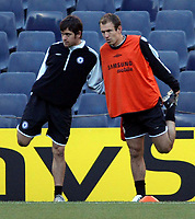 Photo: Chris Ratcliffe.<br />Chelsea Training Session. UEFA Champions League. 06/03/2006. <br />Chelsea's Joe Cole and Arjen Robben.