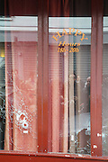 Bullet holes in window panes. Le Carillon, Corner of Rue Bichat and Rue Aubert<br />