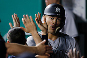 New York Yankees' Giancarlo Stanton is congratulated in the dugout after scoring in the sixth inning of a baseball game against the Kansas City Royals at Kauffman Stadium in Kansas City, Mo., Friday, May 18, 2018. (AP Photo/Colin E. Braley)