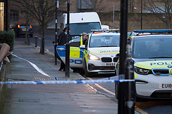 © Licensed to London News Pictures.25/01/2021, London,UK. Police guard a scene in Whitechapel, east London after a women in her 30s or 40s has been found suffering a number of injuries at 8:17am on Sunday. Despite the effort of police and paramedics she was pronounced dead at the scene. A man was arrested on suspicion of murder. Photo credit: Marcin Nowak/LNP