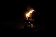 Polynesian fire dancer in Hawaii