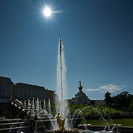 Peterhof, Russia -- July 21, 2019.  A backlit photo of fountains in the gardens of the summer palace.