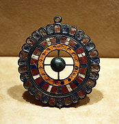 Disk Brooch.  Copper alloy inlaid with millefiore enamel.  Roman.  Made 100-300, probably in Gaul.