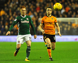 Ryan Woods of Brentford competes with Diogo Jota of Wolverhampton Wanderers - Mandatory by-line: Nizaam Jones/JMP - 02/01/2018 - FOOTBALL - Molineux - Wolverhampton, England- Wolverhampton Wanderers v Brentford -Sky Bet Championship