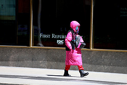Woman is walking on Sixth Avenue during the Covid-19 pandemic in New York City, NY, USA on April 22, 2020. The Big Apple neared a painful milestone Wednesday as the death toll from the coronavirus outbreak that has ravaged the five boroughs approached 15,000. The pandemic has claimed the lives of 14,996 New Yorkers, with new 569 fatalities reported in the most recent 24-hour period, according to data from the city's Department of Health. Photo by Charles Guerin/ABACAPRESS.COM