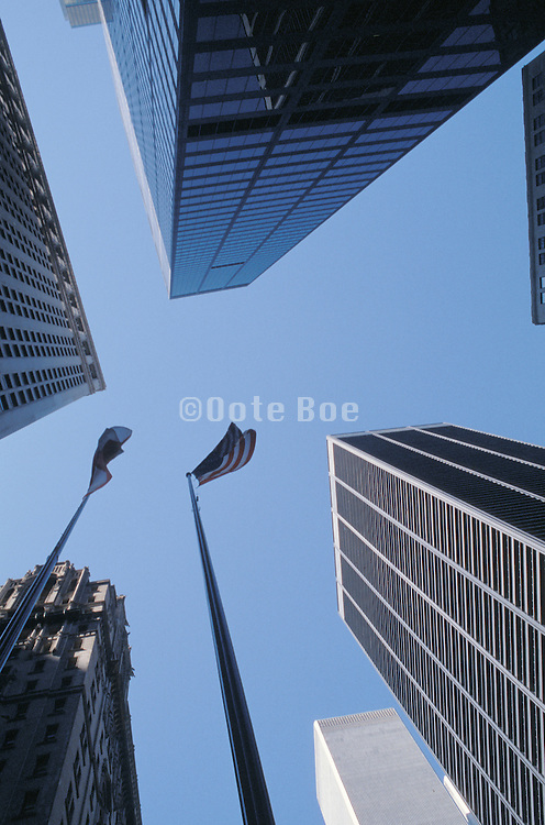 upward view of offices and flagpoles in NYC