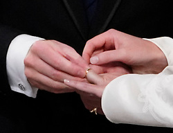 Jack Brooksbank places the ring on the finger of his bride Princess Eugenie during their wedding ceremony at St George's Chapel in Windsor Castle.