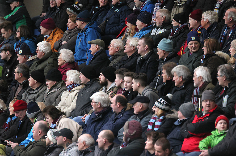 Burnley fans watch the first half action<br /> <br /> Photographer Rich Linley/CameraSport<br /> <br /> Football - Barclays Premiership - Burnley v Swansea City - Friday 27th February 2015 - Turf Moor - Burnley<br /> <br /> © CameraSport - 43 Linden Ave. Countesthorpe. Leicester. England. LE8 5PG - Tel: +44 (0) 116 277 4147 - admin@camerasport.com - www.camerasport.com