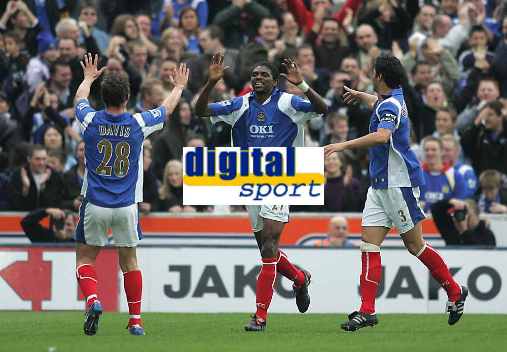 Photo: Lee Earle.<br /> Portsmouth v Reading. The Barclays Premiership. 28/10/2006. Portsmouth's Sean Davis (L) and Dejan Stefanovic (R) congratulate Kanu after his help in scoring their first.