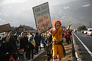 Clown protester on the first day of the Strike WEF march on Davos on 18th of January 2020 near Davos, Switzerland. The first day of the march started in Lanquart with speeches and hot food and ended in Schiers.  The protest is planned to finish in Davos with a public meeting in the town on the day the WEF begins. The march is a three day protest against the World Economic Forum meeting in Davos. The activists want climate justice and think that The WEF is for the worlds richest and political elite only.