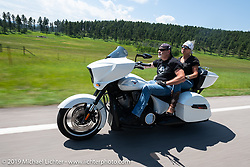 Kathie and Bob Cammisa riding their Victory Cross Country on the Cycle Source Ride up Vanocker Canyon to Nemo during the Sturgis Black Hills Motorcycle Rally. SD, USA. Wednesday, August 7, 2019. Photography ©2019 Michael Lichter.