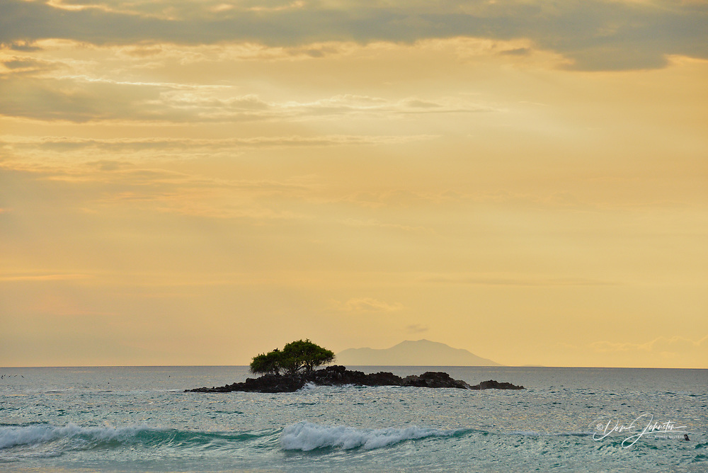 A small island near Las bachas Beach with evening clouds, Galapagos Islands National Park, Santa Cruz Is., Las bachas Beach, Ecuador