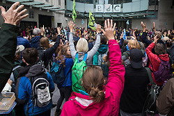 London, UK. 11 October, 2019. Climate activists from Extinction Rebellion hold a citizen's assembly outside the main entrance to the BBC's New Broadcasting House on the fifth day of International Rebellion protests. The activists were demanding a meeting with a senior executive at The BBC and that the broadcaster 'tell the truth' regarding the climate emergency.
