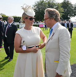 ZARA TINDALL and the EARL OF MARCH at the 2014 Glorious Goodwood Racing Festival at Goodwood racecourse, West Sussex on 31st July 2014.