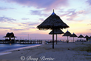 sunset on the beach at Sipadan <br /> Mabul Dive Resort, or SMART,<br /> Mabul Island, off Borneo, <br /> Sabah, Malaysia ( Celebes Sea )