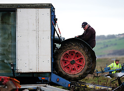 © Licensed to London News Pictures. <br /> 30/11/2014. <br /> <br /> Boulby, United Kingdom<br /> <br /> A farmer reverses his tractor from a lorry at the start of the ploughing match that takes place each year on fields next to the picturesque Yorkshire coastline near Staithes. Farmers attend each year to demonstrate their ploughing skills and to help raise money for charity with proceeds from this year going to Charlie Brown Cancer Care in Newcastle.<br /> <br /> <br /> Photo credit : Ian Forsyth/LNP