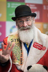 2 December 2019, Madrid, Spain: Sustaina Claus from Conscience Land attends day one of COP25 in Madrid. Alongside political leaders and negotiators, COP25 is attended by a broad range of activists trying to promote ambitious action to address climate change.