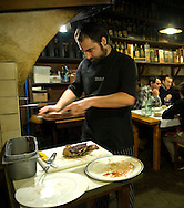 Xabier Gorrotategi prepares grilled cutlets at Casa Julian restaurant in tolosa on December 19, 2014, Basque Country. Matias Gorrotxategi, owner of Casa Julian restaurant, and his son Xabier, work in their restaurant of Tolosa. Casa Julian is specialized in grilled cutlet and too serve piquillo peppers, asparagus of Lodosa and lettuce hearts.(Ander Gillenea / Bostok Photo)