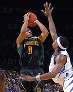Baylor guard Curtis Jerrells (0) hits a three pointer over Kansas State's Luis Colon, during the first half at Bramlage Coliseum in Manhattan, Kansas, January 17, 2007.  K-State beat Baylor 69-60