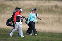 Great Britain's Georgia Hall and her playing partner Lee Slattery walk off the 2nd tee during day ten of the 2018 European Championships at Gleneagles PGA Centenary Course.