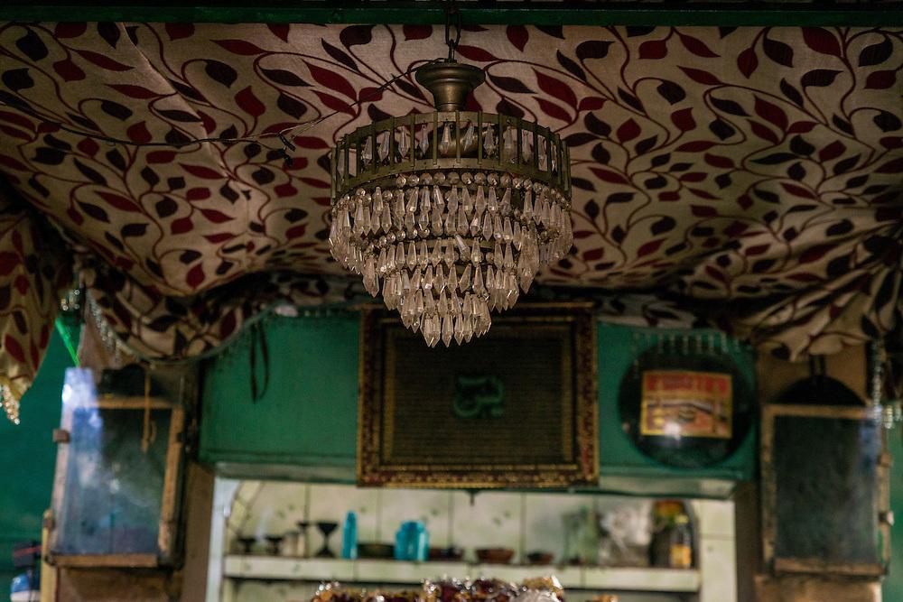 The chandelier above the saints shrine.