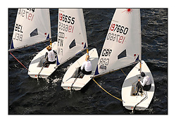 Evi Van Acker, BEL 197514, Sari Multala, FIN 196655 and Charlotte Dobson, GBR 197660.Day 4 of racing at the Laser Radial World Championships taking place at Largs, Scotland GBR. ..118 Women from 35 different nations compete in the Olympic Women's Laser Radial fleet and 104 Men from 30 different nations. .All three 2008 Women's Laser Radial Olympic Medallists are competing. .The Laser Radial World Championships take place every year. This is the first time they have been held in Scotland and are part of the initiaitve to bring key world class events to Britain in the lead up to the 2012 Olympic Games. .The Laser is the world's most popular singlehanded sailing dinghy and is sailed and raced worldwide. ..Further media information from .laserworlds@gmail.com.event press officer mobile +44 7775 671973  and +44 1475 675129 .