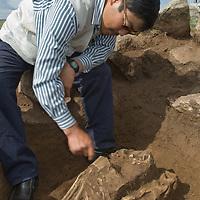 "Mongolian archaeologist Jamsranjav Bayarsaikhan (""Bayaraa"") unearths ancient horse skull in a 2700+ year-old, bronze age  ""khirigsuur"" burial mound at Ulaan Tolgoi archaeological site near Lake Erkhel, north of Muren, Mongolia."