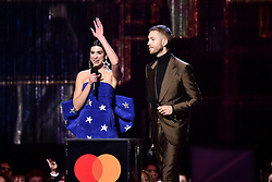 Dua Lipa and Calvin Harris with the award for Best British Single on stage at the Brit Awards 2019 at the O2 Arena, London. Photo credit should read: Matt Crossick/EMPICS Entertainment. EDITORIAL USE ONLY