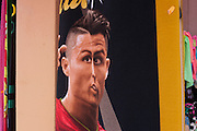 National hero, footballer Christiano Ronaldo's distorted face on beach towel merchandise, in Barra, Costa Nova, Aveiro, Portugal.