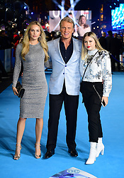 Dolph Lundgren (centre) with daughters Ida Lundgren (left) and Greta Lundgren attending the Aquaman premiere held at Cineworld in Leicester Square, London.