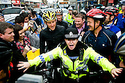 Lance Armstrong cycled in Paisley with around 70 other cyclists after announcing the ride on Twitter.<br /> <br /> A police woman holds back fans as they try to get books signed and meet their hero, while Lance stands looking bemused.<br /> <br /> © John Linton<br /> All rights reserved