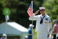 May 25, 2018 - Surrey, Michigan, United Kingdom - A member of the US Navy salutes th American flag on the 9th green in honor of Memorial Day during the second round of the LPGA Volvik Championship at Travis Pointe Country Club, Ann Arbor, MI, USA Friday, May 25, 2018. (Credit Image: © Jorge Lemus/NurPhoto via ZUMA Press)