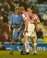 Photo. Glyn Thomas. 22/02/2005.<br /> Coventry City v Stoke City. Coca Cola Championship.<br /> Tempers flare as Coventry's Claus Jorgensen (L) squares up to Clint Hill.