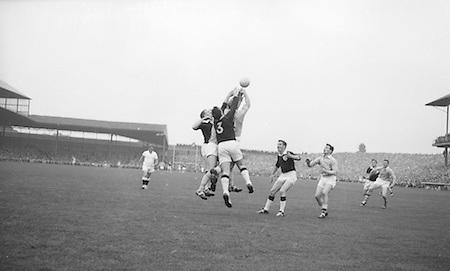All Ireland Senior Football Final Galway v. Dublin 22nd September 1963 Croke Park...N. Tierney (3) Galway Full Back punches clear ..22.09.1963  22nd September 1963Dublin.1-9.Galway.0-10..P. Flynn, L. Hickey, L. Foley, W. Casey, D. McKane, P. Holden, M. Kissane, D. Foley (Captain), John Timmons, B. McDonald, Mickie Whelan, G. Davey, S. Behan, D. Ferguson, N. Fox..Sub: P. Downey for P. Holden..D. Foley (Captain).