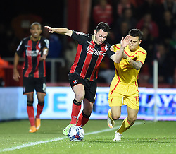 Bournemouth's Adam Smith is challenged by Liverpool's Philippe Coutinho - Photo mandatory by-line: Paul Knight/JMP - Mobile: 07966 386802 - 17/12/2014 - SPORT - Football - Bournemouth - Goldsands Stadium - AFC Bournemouth v Liverpool - Capital One Cup