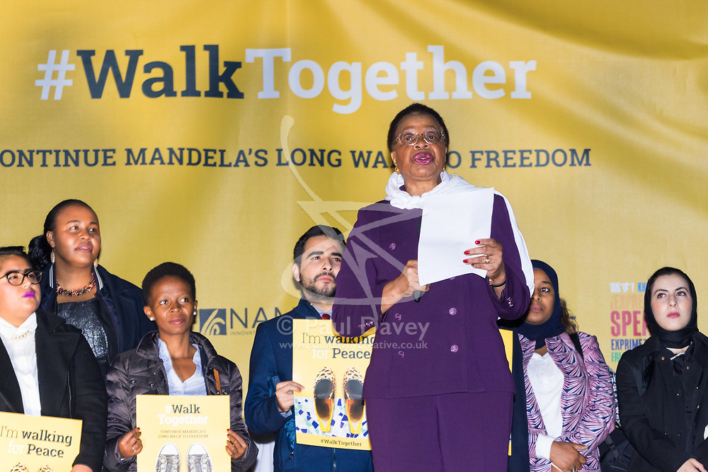 """London, October 23 2017. Nelson Mandela's group of Elders including former UN Secretary General Kofi Annan and Secretary General Ban Ki-moon accompanied by his widow Graca Machel gather at Parliament Square at the start of the Walk Together event in memory of Nelson Mandela before a candlelight vigil at his statue in Parliament Square. """"WalkTogether is a global campaign to inspire hope and compassion, celebrating communities working for the freedoms that unite us"""". PICTURED: Mandela's widow Graca Machel addresses the crowd in Trafalgar Square. © Paul Davey"""