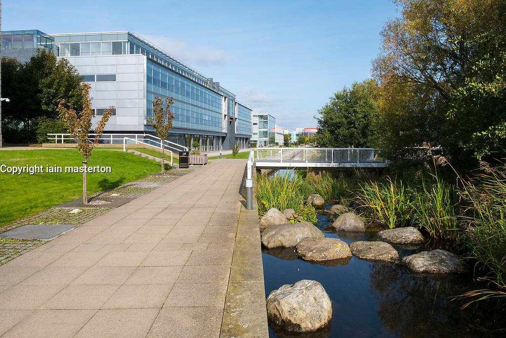 Modern office buildings and landscaped park  at Edinburgh Park a modern business park at South Gyle in Edinburgh, Scotland, United Kingdom.