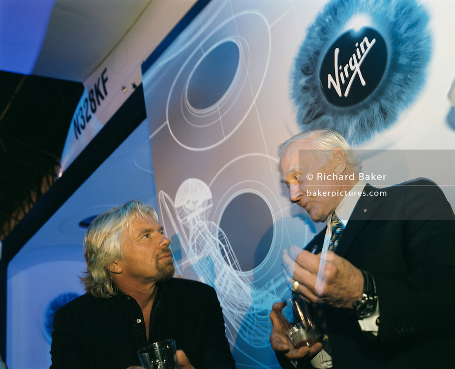 Virgin boss Sir Richard Branson and former Apollo (11) astronaut Buzz Aldrin chat after Virgin Galactic's SpaceShipTwo's unveiling at the New York Wired NextFest at the Jacob K. Javits Convention Center. Under construction by Burt Rutan in Mojave, California and looking more like '2001 A Space Odyssey,' than future everyday holidays, SpaceShipTwo is a re-usable orbiting vehicle that will become an important tool for Man's leisure time in space when affordable commercial space tourism starting in 2009/10. Aboard the space vehicle will be 6 passengers, each paying $200,000 for the 40 minute flight to 360,000 feet (109.73km, or 68.18 miles) and to experience 6 minutes of weighlessness.