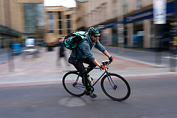 Glasgow, Scotland, UK. 1 April, 2020. Effects of Coronavirus lockdown on streets of Glasgow, Scotland. Deliveroo cyclist rides past Sauchiehall Street. Iain Masterton/Alamy Live News