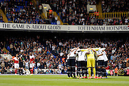 The Tottenham team huddle up before kick off .Barclays premier league match ,Tottenham Hotspur v Fulham at White Hart Lane in Tottenham, London  on Saturday 19th April 2014.<br /> pic by John Patrick Fletcher, Andrew Orchard sports photography.