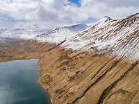 Aerial view of snowy mountains and bay in Alaska, Dutch Harbor.