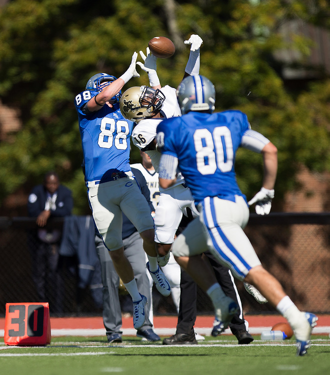 Yosa Nosamiefan, of Trinity College, breaks up a pass intended for Mark Snyder, of Colby College, during a NCAA Division III football game on September 26, 2015 against Trinity College in Waterville, ME. (Dustin Satloff/Colby College Athletics)