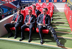 (left-right) Arsenal's Emiliano Martinez, Santi Cazorla and Gabriel Paulista sit on the bench during the Emirates FA Cup Final at Wembley Stadium, London.
