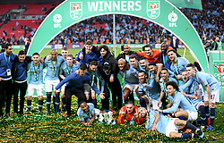 Manchester City players and staff celebrate winning the Carabao Cup Final at Wembley Stadium, London.