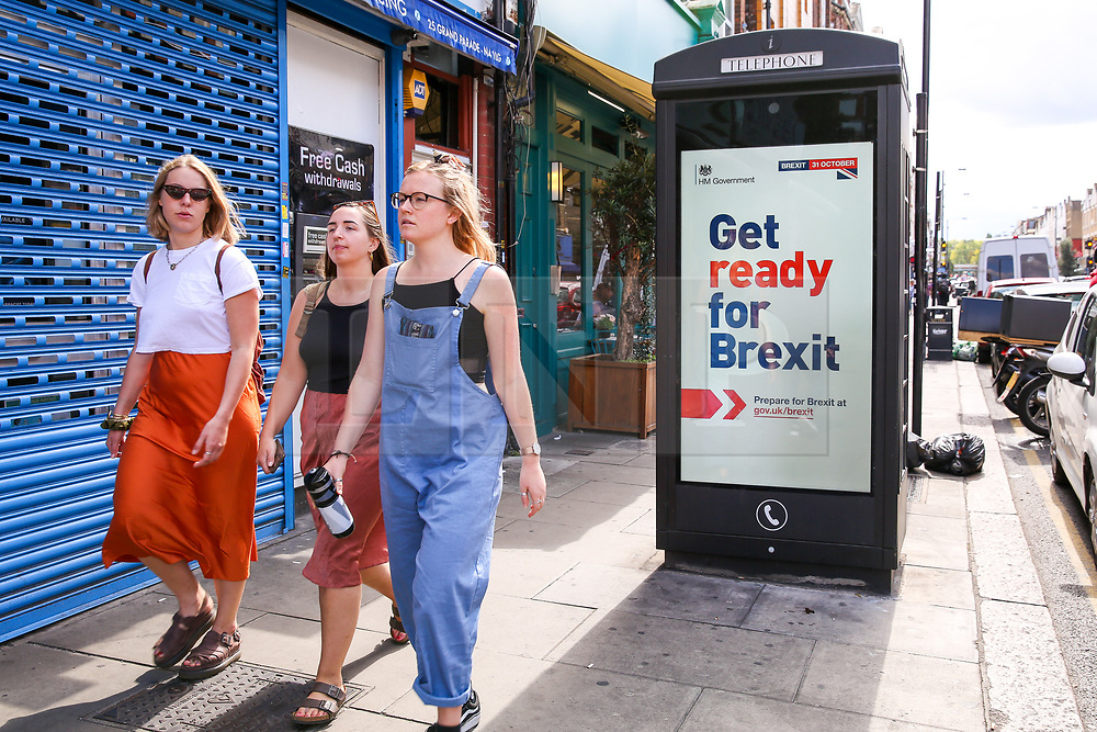 "© Licensed to London News Pictures. 01/09/2019. London, UK. Women walk past the new ""Get ready for Brexit"" advert on a telephone box in north London. <br /> Today, the UK Government launches its £100m ""Prepare for Brexit"" advertising campaign to reassure the nation ahead of a potential no-deal departure from the European Union on 31 October. Photo credit: Dinendra Haria/LNP"