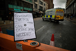 © Licensed to London News Pictures. 01/09/2019. Manchester, UK. Government inaction makes civil disobedience necessary placard in front of a police van . Extinction Rebellion block roads around Deansgate in Manchester City Centre , during a third day of planned disruption organised by environmental campaigners . Manchester City Council has declared a climate emergency but activists say the council's development plans do not reflect this . Photo credit: Joel Goodman/LNP