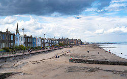 View along beach with a cloudy sky at Portobello in Scotland, UK