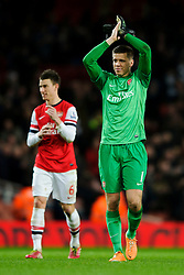 Arsenal Goalkeeper Wojciech Szczesny (POL) appleuds the supporters after Arsenal win the match 2-0 - Photo mandatory by-line: Rogan Thomson/JMP - Tel: Mobile: 07966 386802 - 18/01/14 - SPORT - FOOTBALL - Emirates Stadium - Arsenal v Fulham - Barclays Premier League.